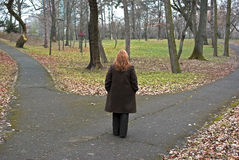 woman standing between two paths