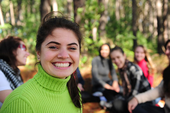 Girl with friends in the forest